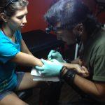hand woman body scarification - suku suku tatau